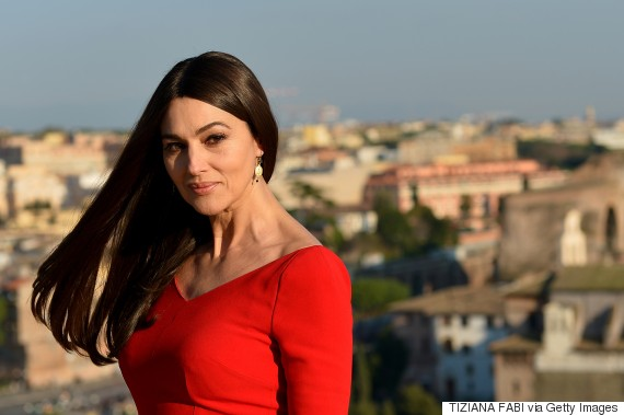 Italian actress Monica Bellucci poses during a photocall to promote the 24th James Bond film 'Spectre' on February 18, 2015 at Rome's city hall. AFP PHOTO / TIZIANA FABI (Photo credit should read TIZIANA FABI/AFP/Getty Images)